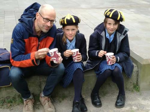 Hereford Cathedral Junior School pupils Bethan N and Isabel N with their dad on World Porridge Day