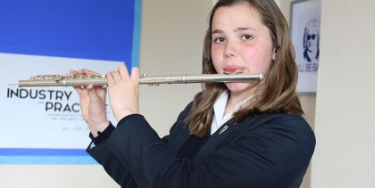 Dimity playing the flute