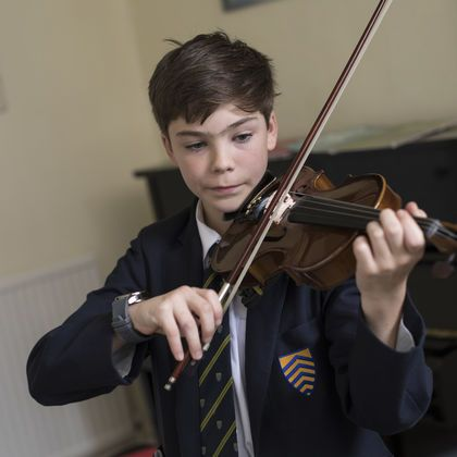 School pupil with violin
