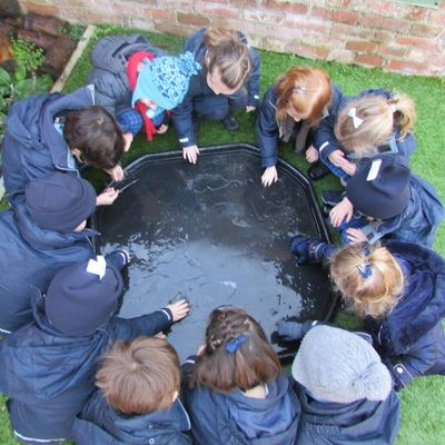 Nursery children break the ice in the garden